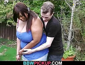 Ebony fatty spreads her legs for white meat