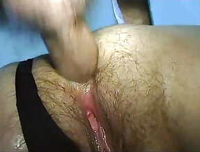 Homemade video of a mature woman in mask banged by younger