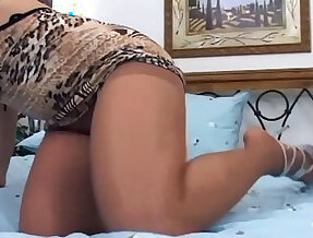 Pretty redhead in nude pantyhose fucking on a bed
