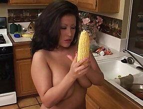 Fat brunette inserts corn and cucumbers in pussy