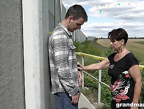 Adult unladylike over 60 gives a blowjob to hot young guy outdoor