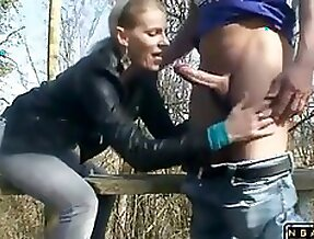 Blondie milf swallows a studs large prick and takes it in her cunt out in the woods